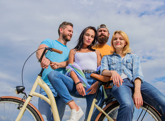 Share or rental bike service. Group friends hang out with bicycle. Bicycle as best friend. Cycling modernity and national culture. Company stylish young people spend leisure outdoors sky background