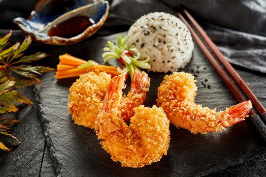 Three prawn tails fried in crispy tempura batter