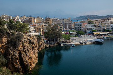 View of Greek town Aghios Nikolaos and the the small lagoon Lake Voulismeni