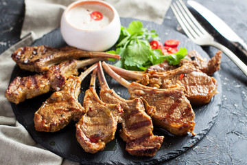 Grilled lamb ribs with spices and yoghurt sauce