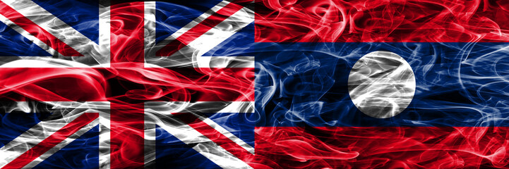 United Kingdom vs Laos smoke flags placed side by side. Thick colored silky smoke flags of Great Britain and Laos