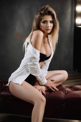 beautiful girl in white shirt and lingerie in studio