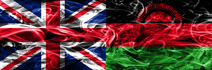 United Kingdom vs Malawi smoke flags placed side by side. Thick colored silky smoke flags of Great Britain and Malawi