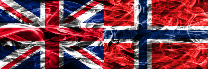 United Kingdom vs Norway smoke flags placed side by side. Thick colored silky smoke flags of Great Britain and Norway
