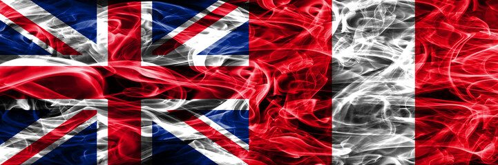United Kingdom vs Peru smoke flags placed side by side. Thick colored silky smoke flags of Great Britain and Peru