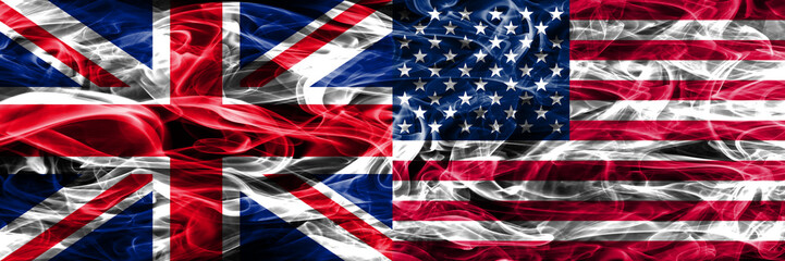 United Kingdom vs United States of America smoke flags placed side by side. Thick colored silky smoke flags of Great Britain and United States of America