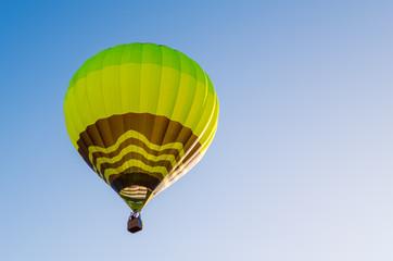 Foto op Aluminium Luchtsport Colorful hot air balloon against the blue sky