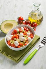 salad with mozzarella tomatoes and avocado