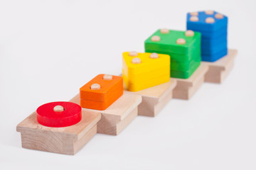 Wooden baby blocks on a white background