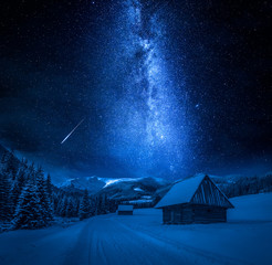 Fototapete - Falling stars, cottages and snowy road at night, Tatra Mountains
