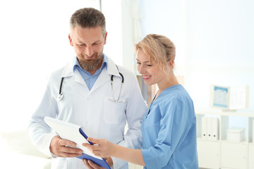 Doctor and medical assistant working in clinic. Health care service