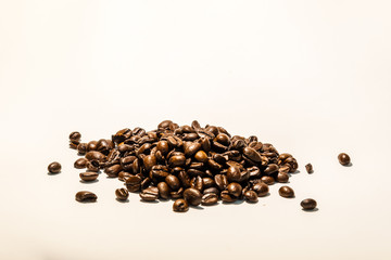 Roasted coffee beans image on white background, with space for text. Check my profile for similar images.
