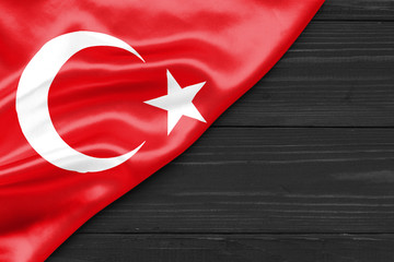 Flag of Turkey and place for text on a dark wooden background