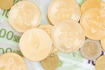 Photo of different type of currency: bitcoin, ethereum and false euros.