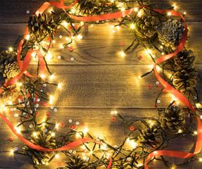 Christmas Light or Garland Lights on Wood Background