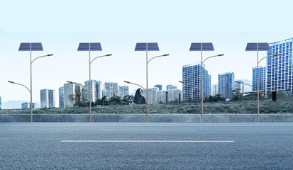 Modern city, asphalt road and solar street lights on both sides
