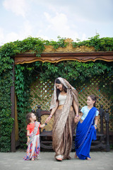 Small children and their mother in traditional Indian attire.