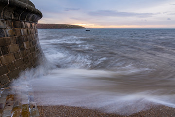 Wave breaks over slipway at Filey, North Yorkshire, UK.