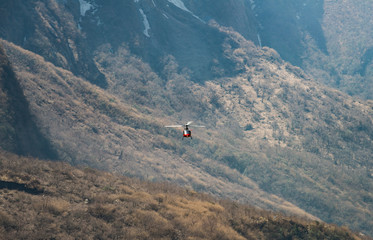 Helicopter rescue in Himalayas mountains range, Nepal.