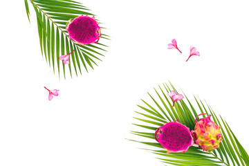 Foot composition of dragon fruits, flowers and palm leaves on white background. Flat lay, top view.