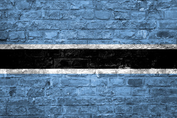 Flag of Botswana over an old brick wall background, surface