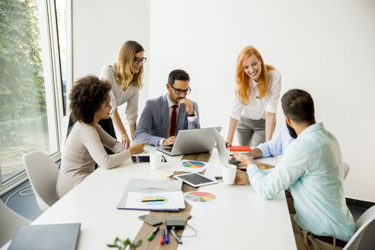 Multiracial business people working in office