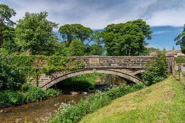Stone bridge over the Linton Beck, North Yorkshire, England, UK