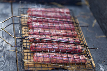 raw sausages for frying on the grill