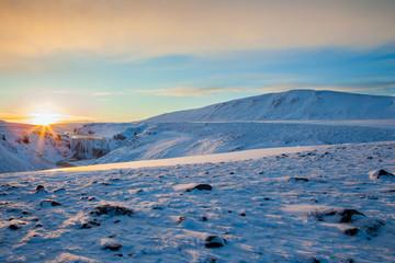 Icelandic sunrise, over ice and snow.