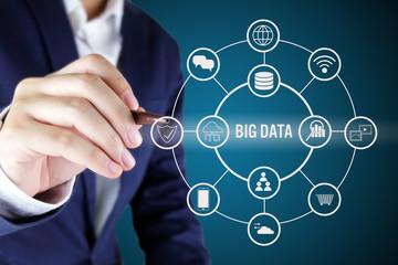 Businessman pointing at Big data Symbol.Big data concept..
