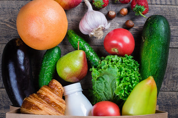 Full Grocery Paper Bag of healthy food fruits and vegetables on a white table background. Top view. Flat lay. Close up