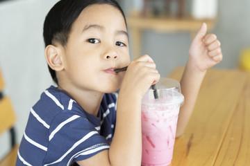 the boy dringking iced milk