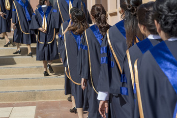 The graduates entered the auditorium to attend the graduation ceremony.