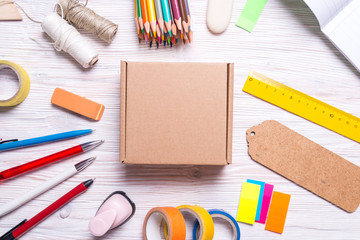 Cardboard box and stationery on wooden background, top view Wall mural