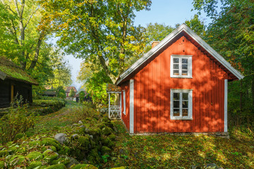 Picturesque red house in an old village