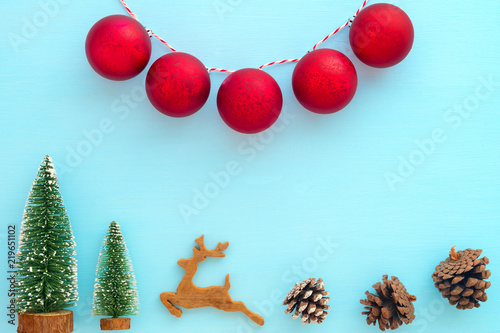 christmas and new year background christmas tree reindeer pine cones and red balls