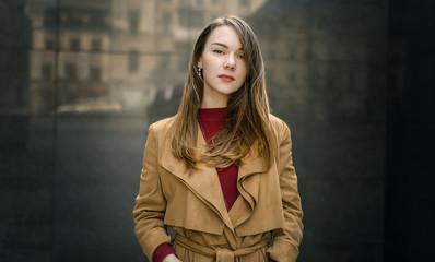 Woman in vintage cloak at street.