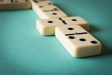 Playing dominoes on a light background . The concept of the game of dominoes. Close up
