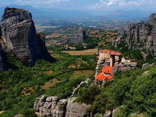 Meteora hermit monastery sitting on tall rock cliffs in Greece