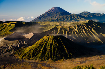 Mount Bromo volcano observed from the caldera during sunrise with visible shadows