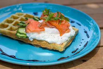 Healthy eating food breakfast waffles, salmon and poached egg