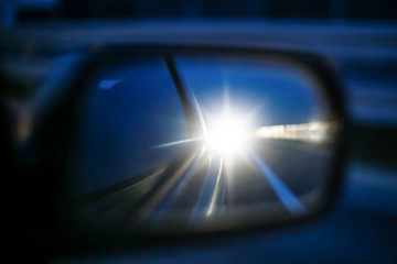 Cars long lights in rear view mirror