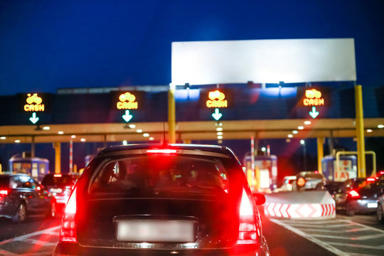 Car waiting on the highway toll booth