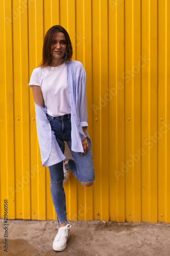 afb9cc527c Full length portrait of a happy beautiful woman which wearing white t-shirt