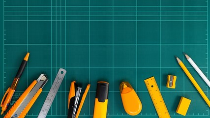 office supplies and stationery on cutting mat. flat lay picture.