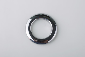 Plastic rings for fastening the fabric to the cornice for curtains. Multicolored plastic eyelets for curtains. Square, rectangular, triangular, round eyelets for curtains.