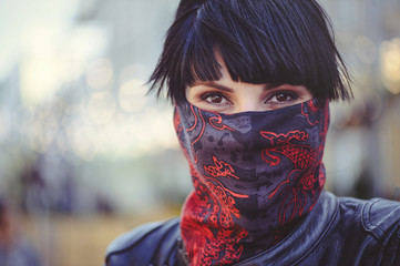woman covers her face with a handkerchief, freedom of speech and tradition, close-up