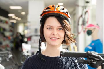 Portrait of smiling female in helmet