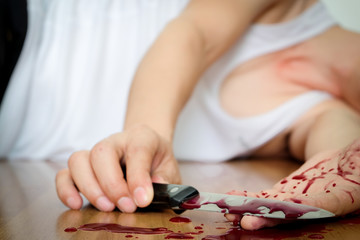 Stress suicide with a knife Gide wrist. Full lay bleeding wrist and a knife.