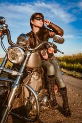 Wall Mural - Biker girl sitting on motorcycle